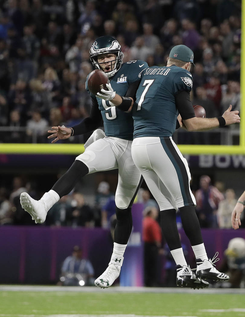 Philadelphia Eagles quarterback Nick Foles celebrates his touchdown catch with Nate Sudfeld (7) during the first half of the NFL Super Bowl 52 football game against the New England Patriots Sunday ...
