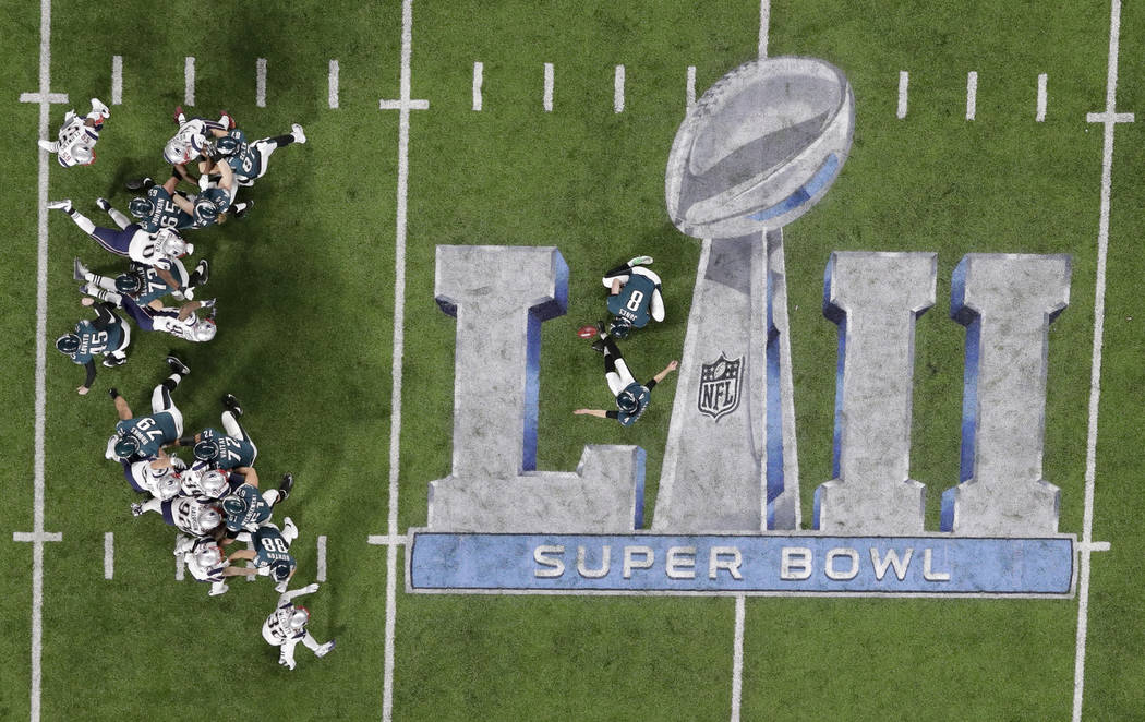 Philadelphia Eagles kicker Jake Elliott kicks an extra point against the New England Patriots during the first half of the NFL Super Bowl 52 football game Sunday, Feb. 4, 2018, in Minneapolis. (AP ...