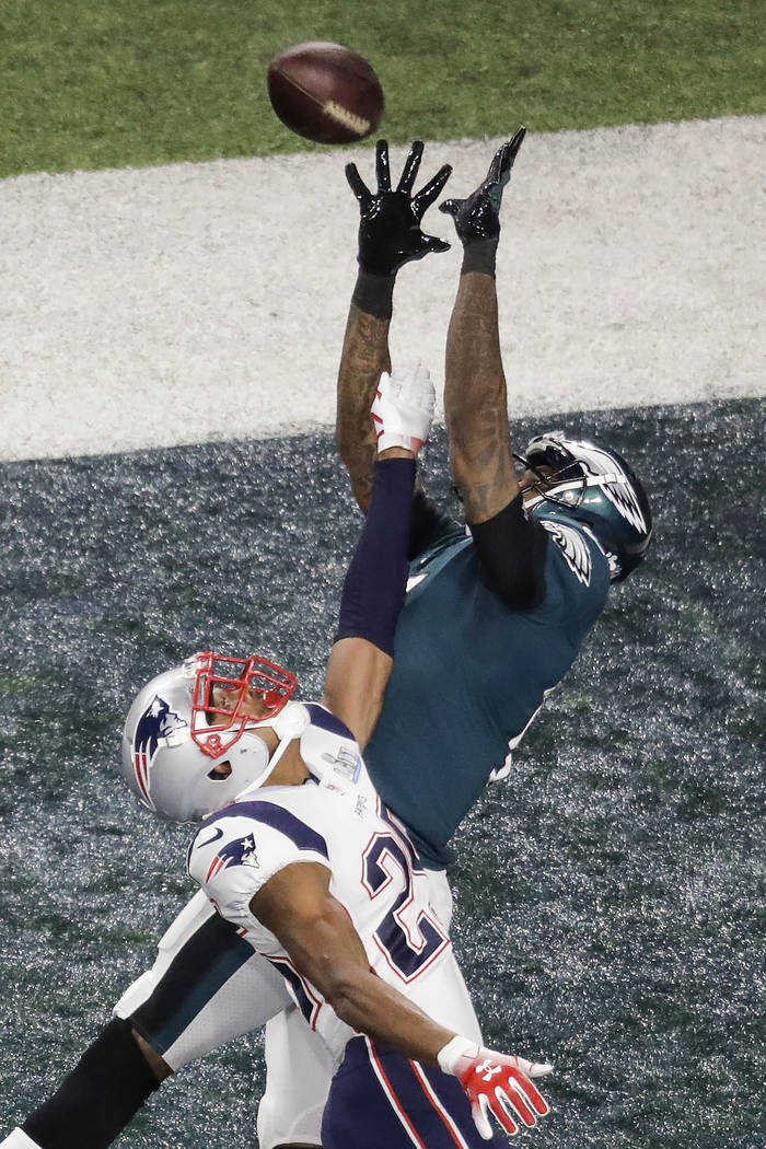 Philadelphia Eagles wide receiver Alshon Jeffery catches a touchdown pass over New England Patriots cornerback Eric Rowe during the first half of the NFL Super Bowl 52 football game Sunday, Feb. 4 ...