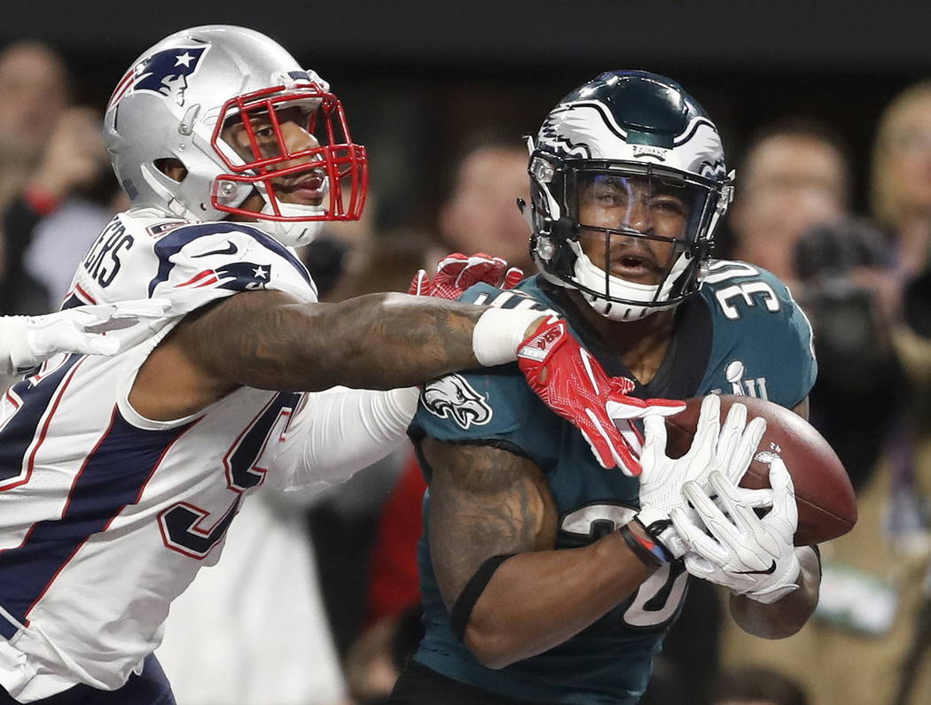 Philadelphia Eagles' Corey Clement, right, catches a touchdown pass in front of New England Patriots' Marquis Flowers during the second half of the NFL Super Bowl 52 football game Sunday, Feb. 4,  ...