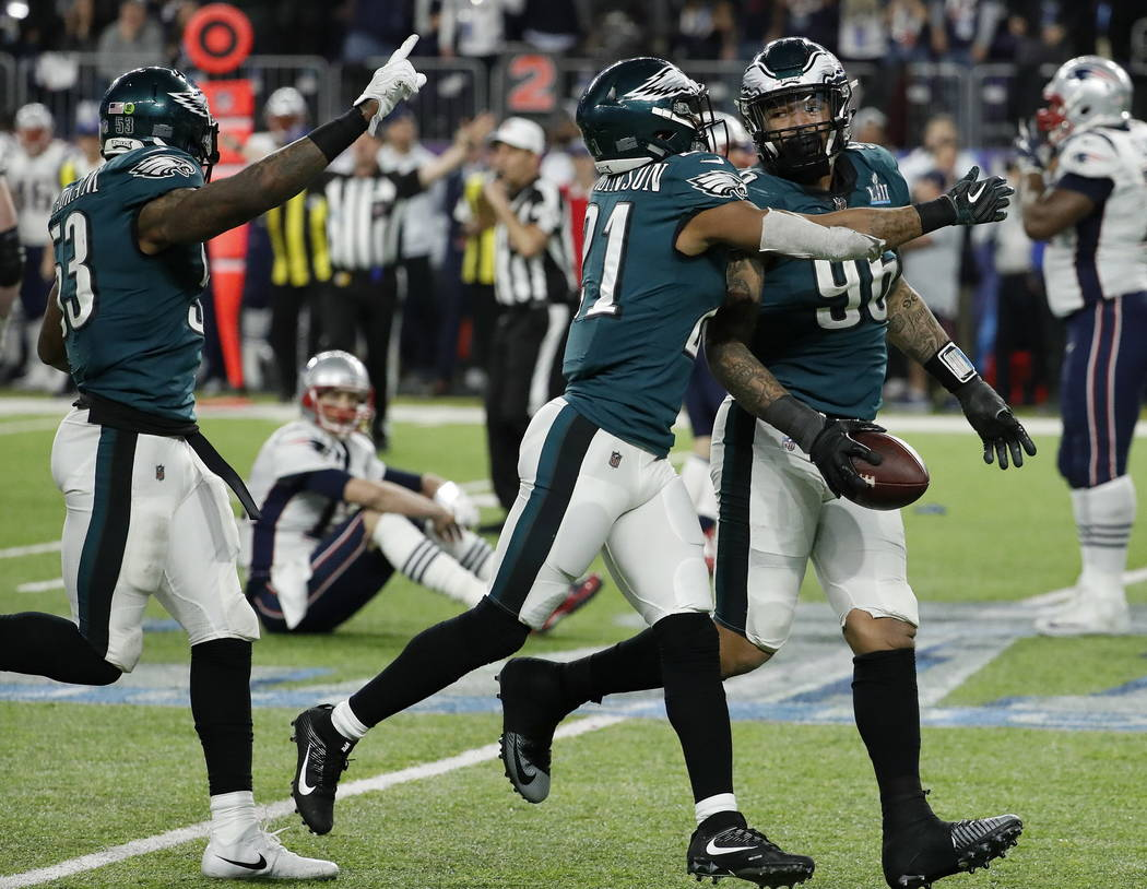 Philadelphia Eagles' Derek Barnett (96) celebrates after recovering a fumble by New England Patriots' Tom Brady, sitting, during the second half of the NFL Super Bowl 52 football game Sunday, Feb. ...