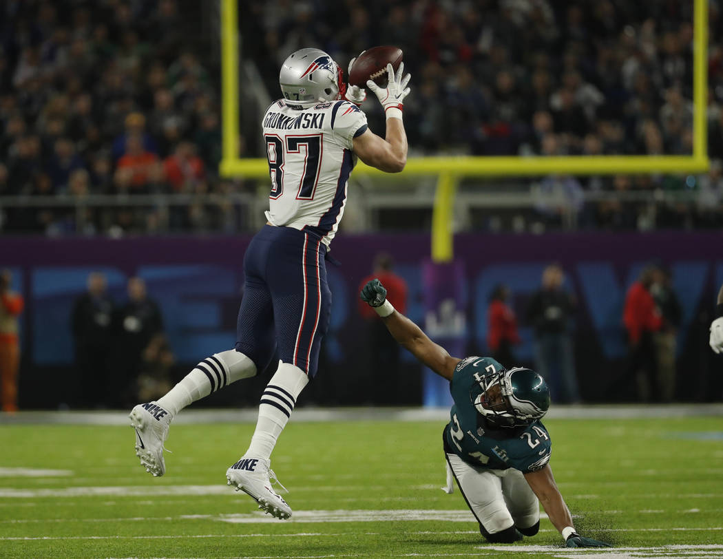 New England Patriots tight end Rob Gronkowski (87) makes a catch over Philadelphia Eagles defensive back Corey Graham (24), during the second half of the NFL Super Bowl 52 football game, Sunday, F ...