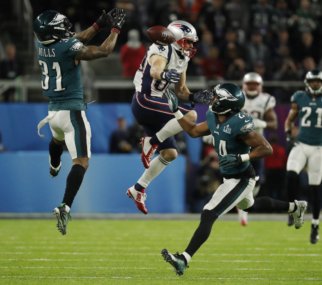 New England Patriots wide receiver Danny Amendola (80) misses a catch against Philadelphia Eagles cornerback Jalen Mills (31) and defensive back Corey Graham (24), during the first half of the NFL ...