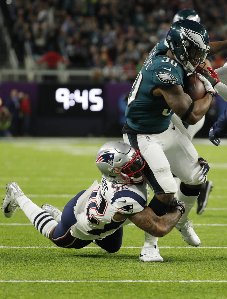 Philadelphia Eagles running back Corey Clement (30) carries the ball, as New England Patriots outside linebacker Elandon Roberts (52) makes the tackle, during the first half of the NFL Super Bowl  ...