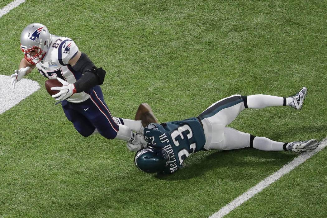 New England Patriots tight end Rob Gronkowski (87) is tackled by Philadelphia Eagles free safety Rodney McLeod Jr. during the first half of the NFL Super Bowl 52 football game Sunday, Feb. 4, 2018 ...