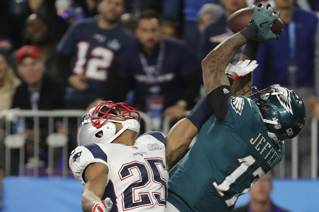 Philadelphia Eagles wide receiver Alshon Jeffery (17), makes a touchdown catch against New England Patriots cornerback Eric Rowe (25), during the first half of the NFL Super Bowl 52 football game, ...