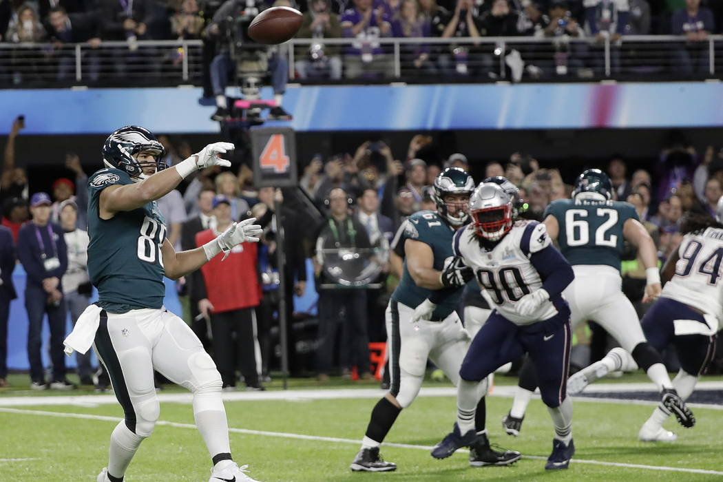 Philadelphia Eagles' Trey Burton, left, throws a touchdown pass to Nick Foles during the first half of the NFL Super Bowl 52 football game against the New England Patriots Sunday, Feb. 4, 2018, in ...