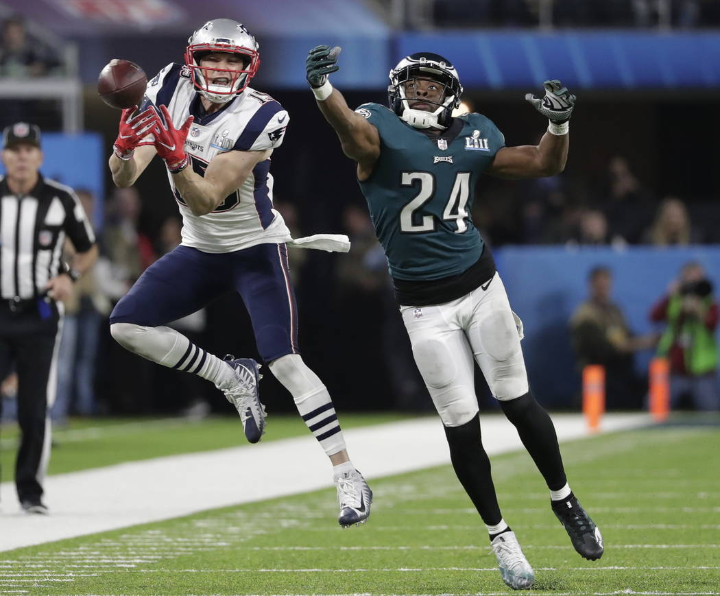 Philadelphia Eagles defensive back Corey Graham (24) breaks up a pass intended for New England Patriots wide receiver Chris Hogan (15), during the second half of the NFL Super Bowl 52 football gam ...