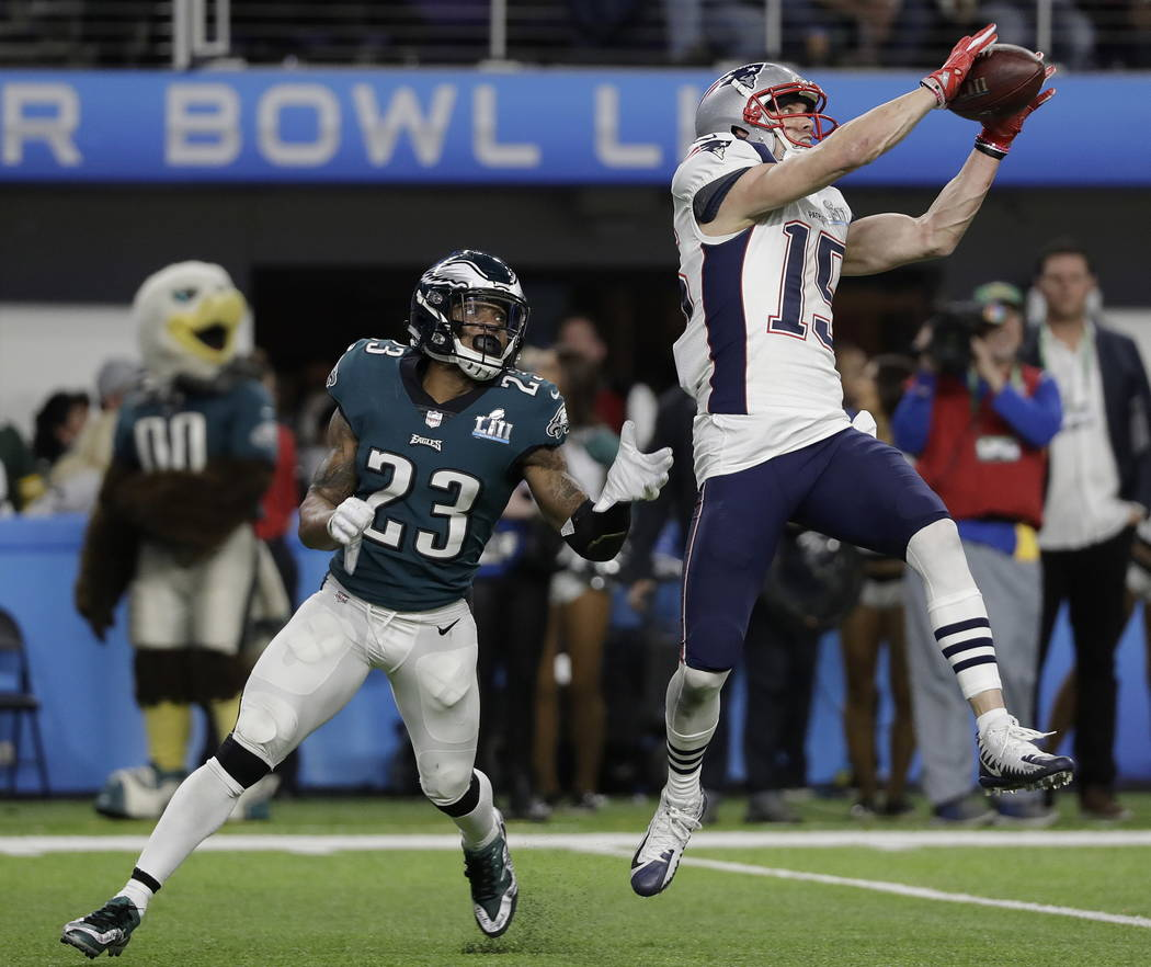 New England Patriots' Chris Hogan catches a touchdown pass during the second half of the NFL Super Bowl 52 football game against the Philadelphia Eagles Sunday, Feb. 4, 2018, in Minneapolis. (AP P ...
