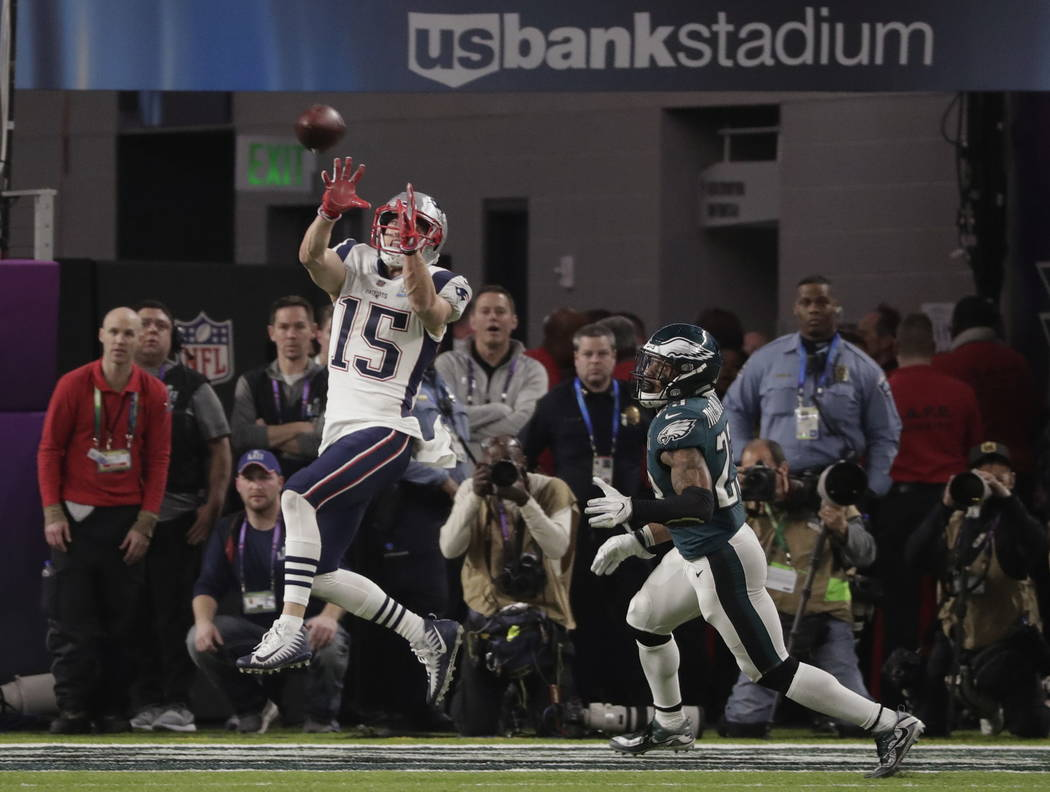 New England Patriots wide receiver Chris Hogan (15) makes a touchdown reception against Philadelphia Eagles free safety Rodney McLeod (23), during the second half of the NFL Super Bowl 52 football ...