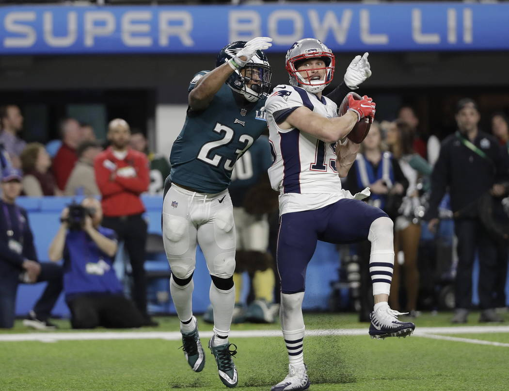 New England Patriots' Chris Hogan, right, catches a touchdown pass in front of Philadelphia Eagles' Rodney McLeod during the second half of the NFL Super Bowl 52 football game Sunday, Feb. 4, 2018 ...