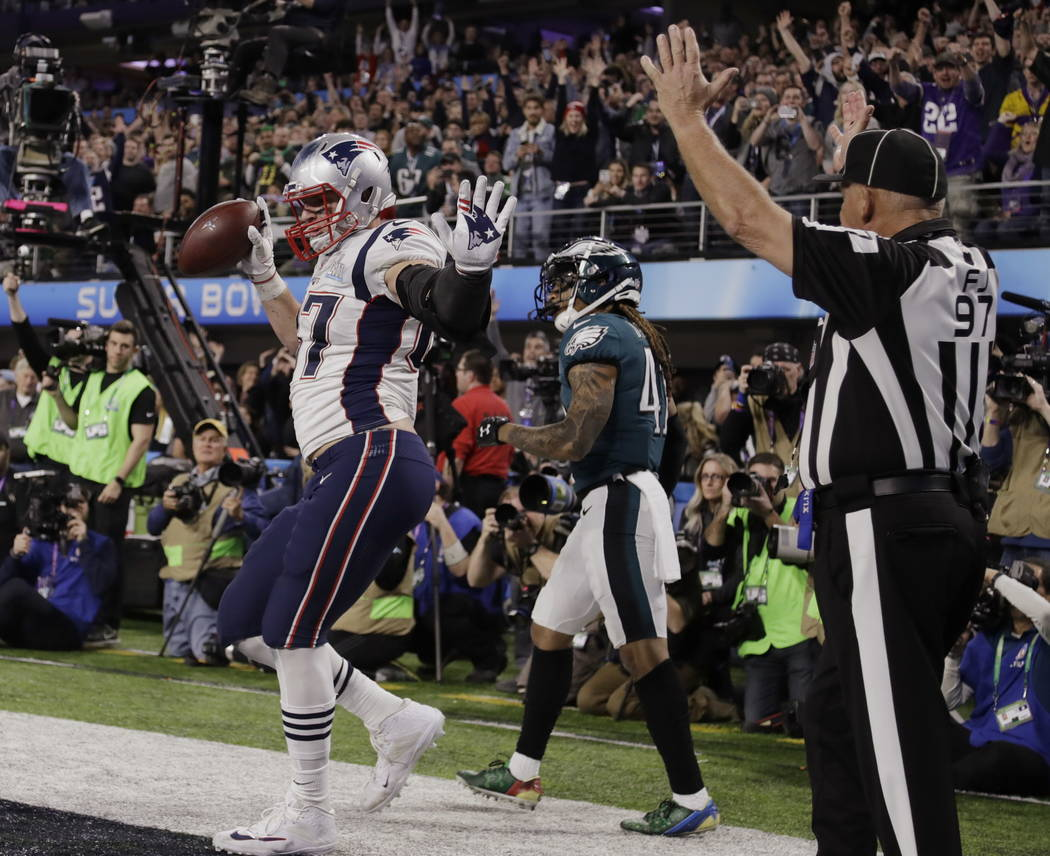 New England Patriots tight end Rob Gronkowski (87) dances as he celebrates a touchdown reception, during the second half of the NFL Super Bowl 52 football game against the Philadelphia Eagles, Sun ...