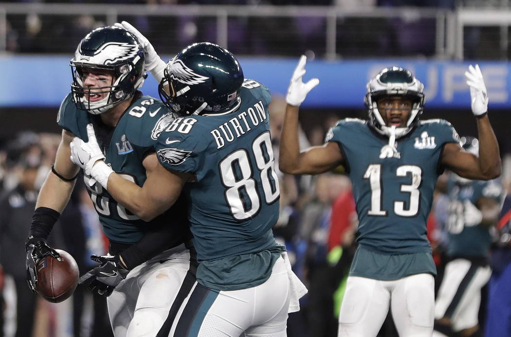 Philadelphia Eagles' Zach Ertz, left, celebrates his touchdown catch during the second half of the NFL Super Bowl 52 football game against the New England Patriots Sunday, Feb. 4, 2018, in Minneap ...