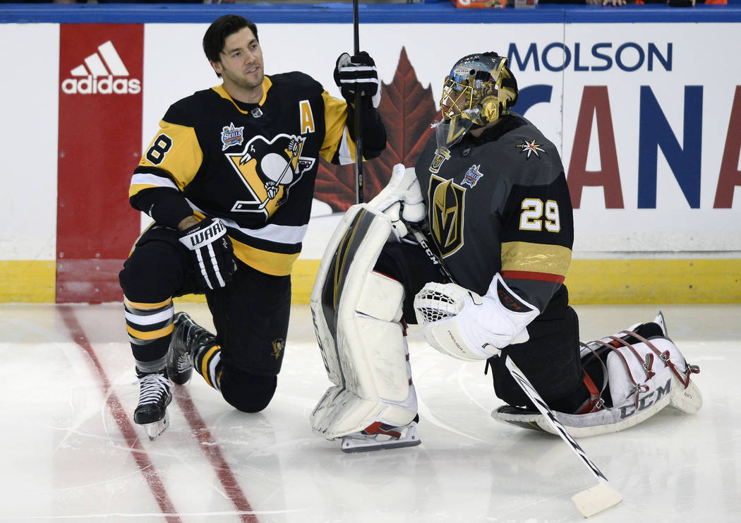 Pittsburgh Penguins defenseman Kris Letang (58) talks to a former teammate, Vegas Golden Knights goalie Marc-Andre Fleury (29), before the Skills Competition, one of the NHL All-Star weekend event ...