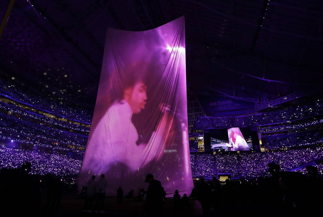 A large image of Prince is shown as Justin Timberlake performs during halftime of the NFL Super Bowl 52 football game between the Philadelphia Eagles and the New England Patriots Sunday, Feb. 4, 2 ...