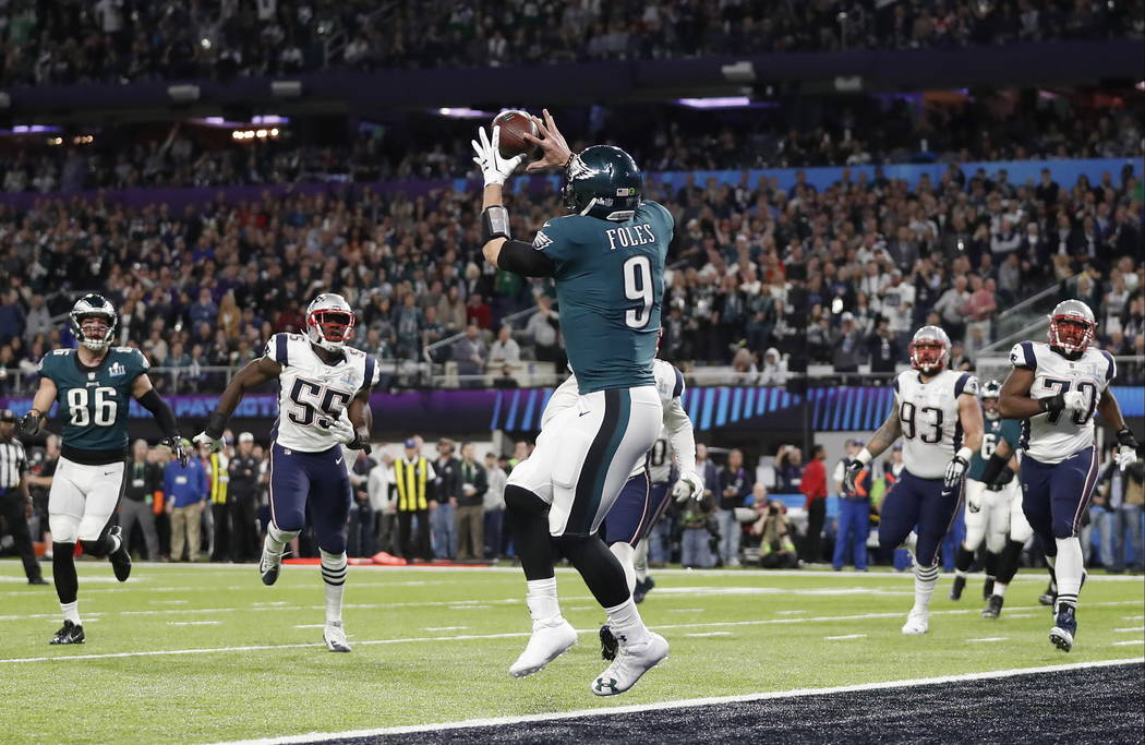 Philadelphia Eagles' Nick Foles catches a touchdown pass during the first half of the NFL Super Bowl 52 football game against the New England Patriots Sunday, Feb. 4, 2018, in Minneapolis. (AP Pho ...
