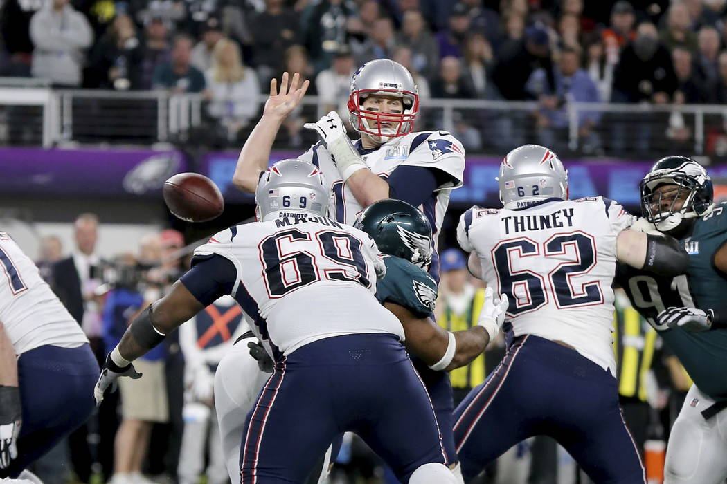 New England Patriots quarterback Tom Brady fumbles after being stripped by Philadelphia Eagles Brandon Graham in the fourth quarter at Super Bowl 52 on Sunday, February 4, 2018 in Minneapolis. (AP ...
