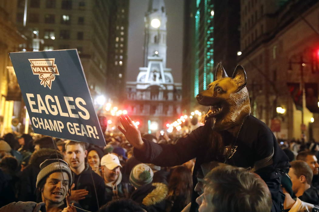 Philadelphia Eagles fans celebrate the team's victory in NFL Super Bowl 52 between the Philadelphia Eagles and the New England Patriots, Monday, Feb. 5, 2018, in downtown Philadelphia. (AP Photo/M ...