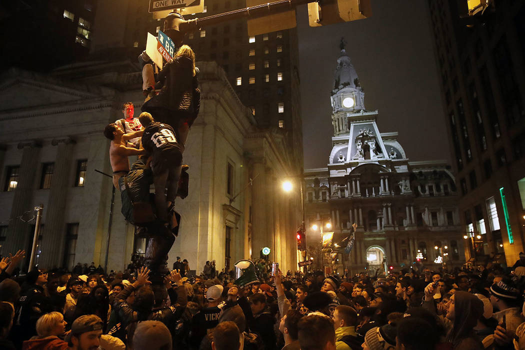 Philadelphia Eagles fans celebrate the team's victory in NFL Super Bowl 52 between the Philadelphia Eagles and the New England Patriots, Sunday, Feb. 4, 2018, in downtown Philadelphia. (AP Photo/M ...