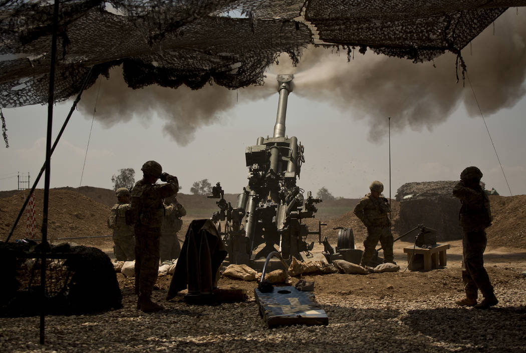 U.S. soldiers from the 82nd Airborne Division fire artillery in support of Iraqi forces fighting Islamic State militants from their base east of Mosul on April 17, 2017. Western contractors at a U ...