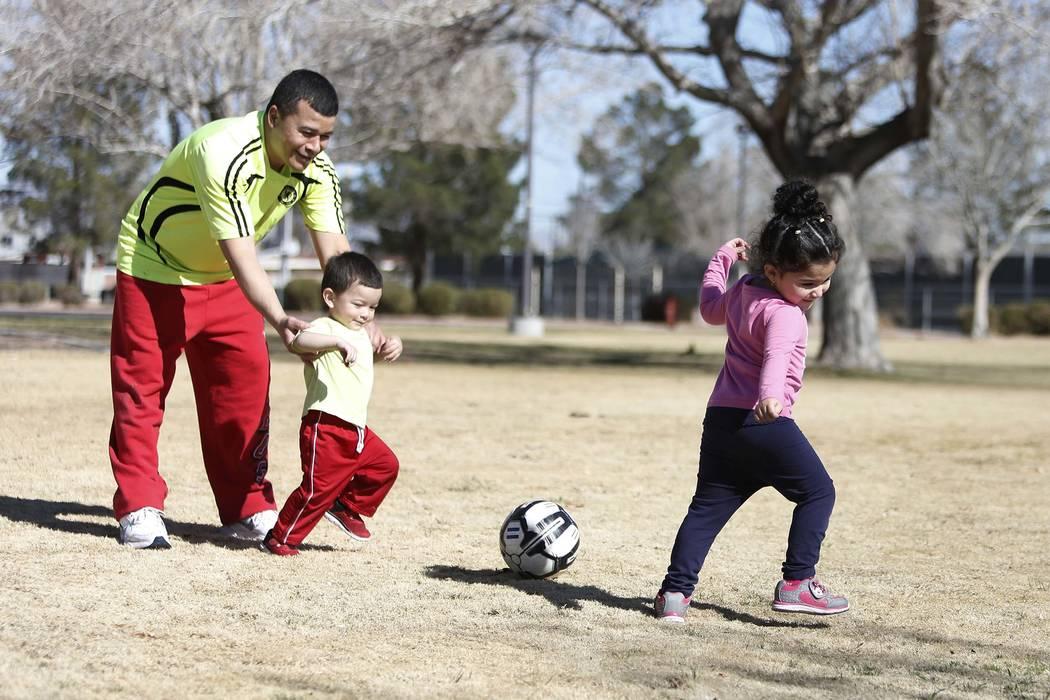 Jefferson Enriquez, 2, center, plays with his father Ivan and sister Alisson, 3, at Lorenzi Park on Monday, Feb. 5, 2018, in Las Vegas. Bizuayehu Tesfaye/Las Vegas Review-Journal @bizutesfaye