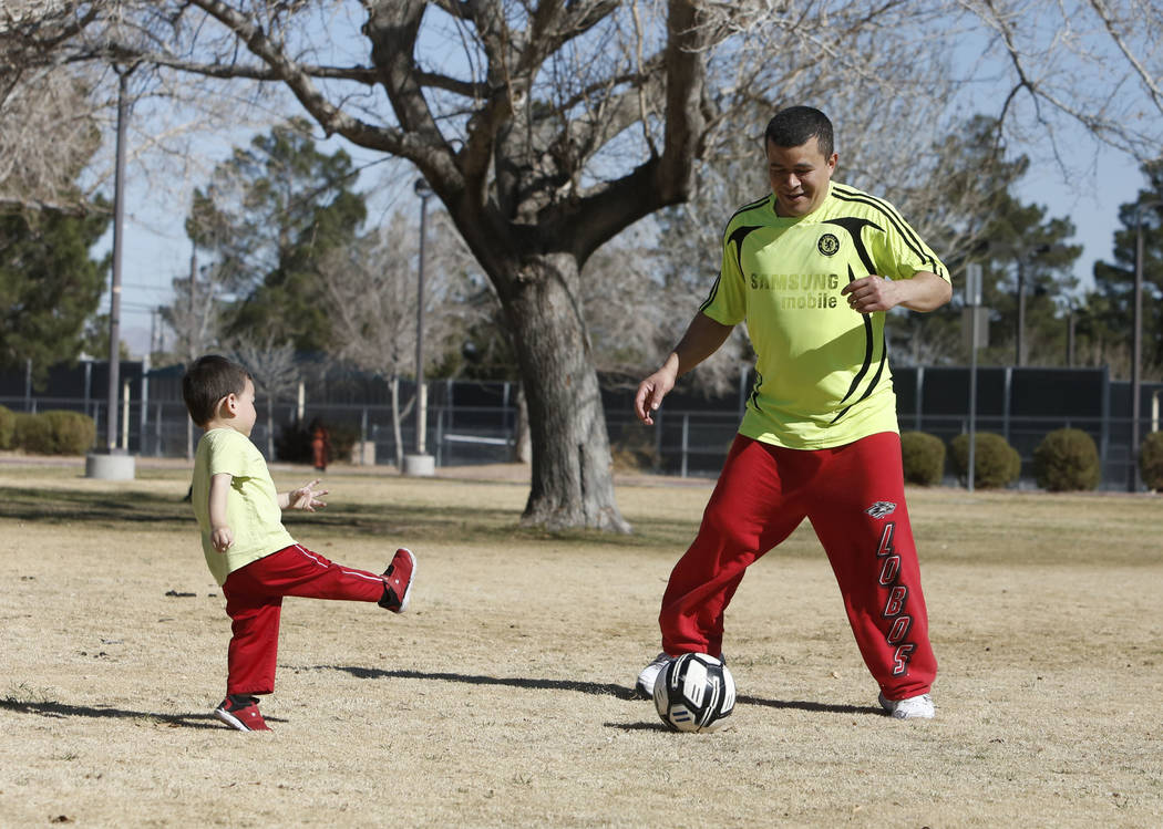 Jefferson Enriquez, 2, plays with his father, Ivan, at Lorenzi Park on Monday, Feb. 5, 2018, in Las Vegas. (Bizuayehu Tesfaye/Las Vegas Review-Journal) @bizutesfaye