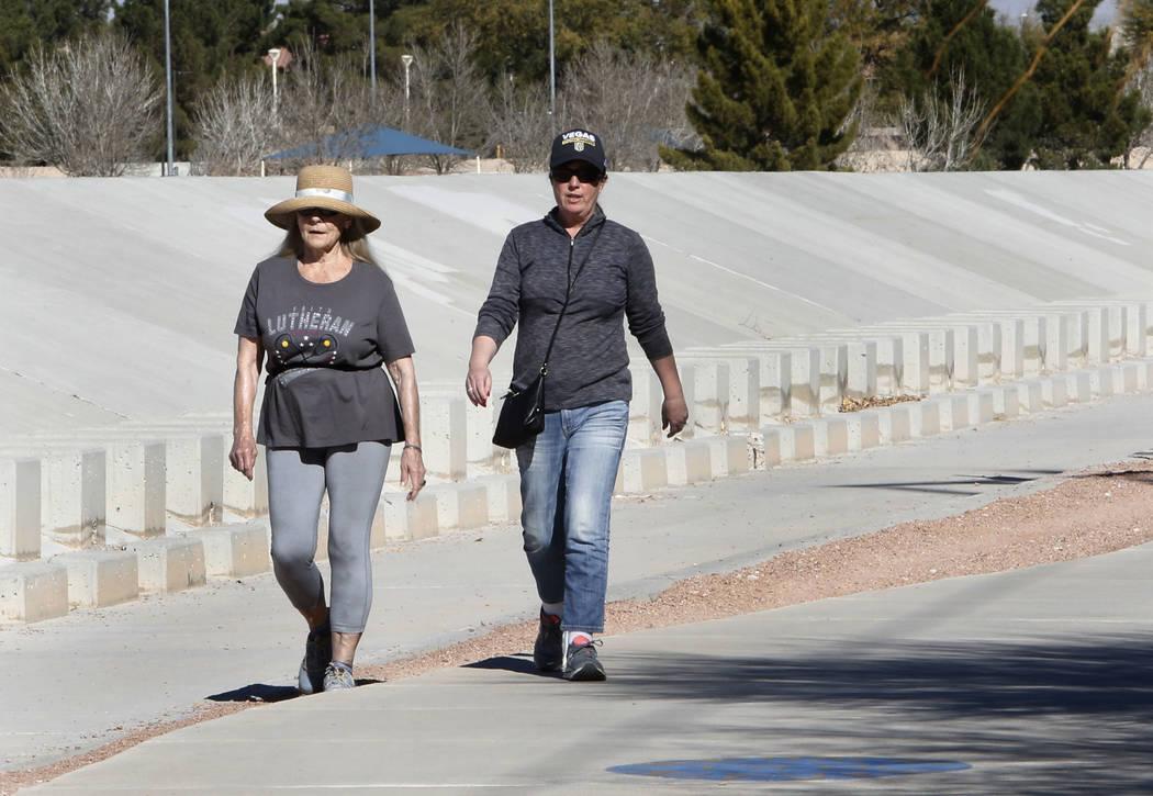 Two women, who declined to give their names, walk during a sunny morning along N. Jory Trail on Monday, Feb. 5, 2018, in Las Vegas. (Bizuayehu Tesfaye/Las Vegas Review-Journal) @bizutesfaye