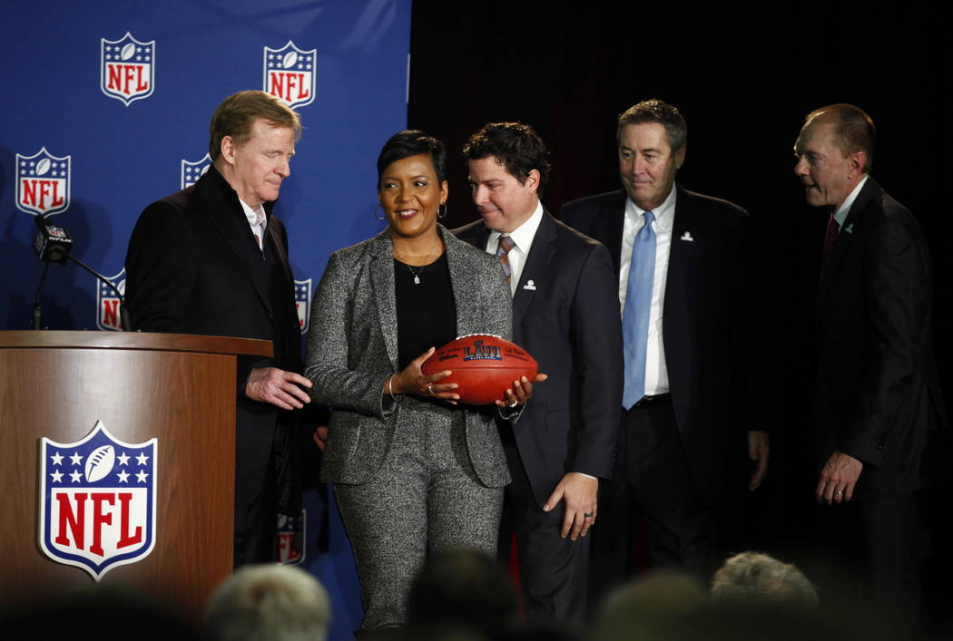 NFL Commissioner Roger Goodell, left, signifies the changing of Super Bowl host cities by handing the Mayor of Atlanta, Keisha Lance Bottoms, a Super Bowl LIII football at the Mall of America in B ...