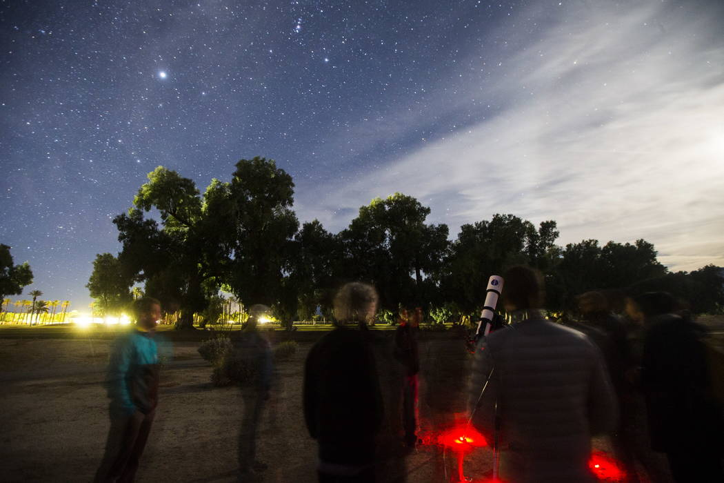 People participate in a stargazing activity led by Greg McKay of the Las Vegas Astronomical Society at the Furnace Creek Golf Course at the Oasis at Death Valley in Death Valley National Park, Cal ...