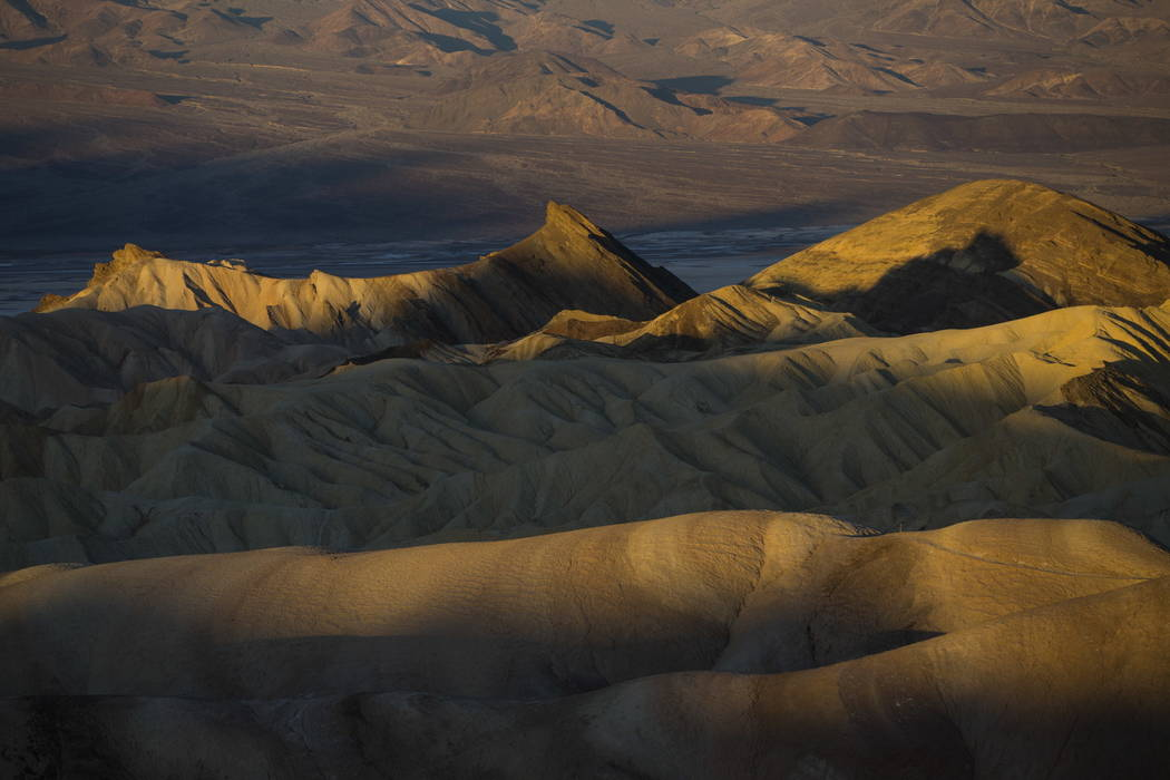 Early morning light touches rock formations as seen from Zabriskie Point in Death Valley National Park, Calif, on Wednesday, Jan. 24, 2018. Chase Stevens Las Vegas Review-Journal @csstevensphoto
