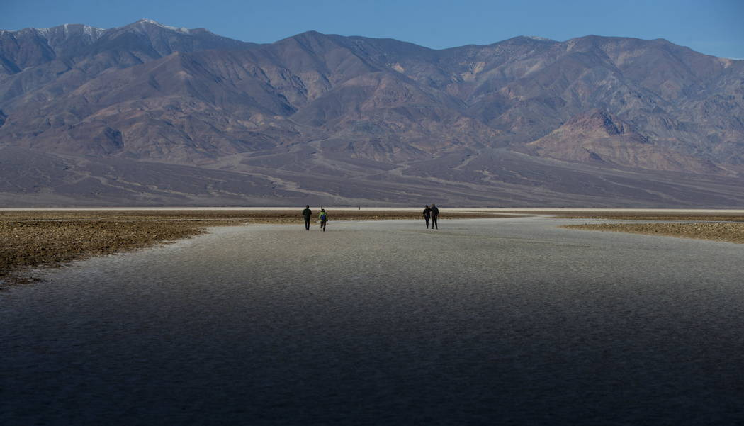 Early morning light at Badwater Basin as mountains in the Panamint Range tower above at Death Valley in Death Valley National Park, Calif, on Wednesday, Jan. 24, 2018. Chase Stevens Las Vegas Revi ...