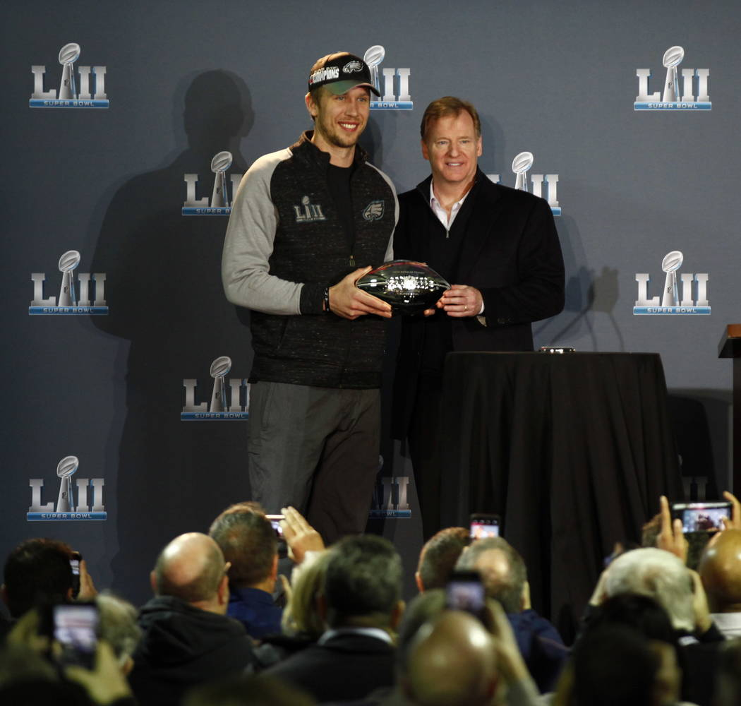 NFL Commissioner Roger Goodell hands off The Pete Rozell trophy to Super Bowl LII's most valuable player, Philadelphia Eagles quarterback Nick Foles, during a news conference at the Mall of Americ ...