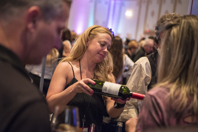 Lisa Furman pours wine for an attendee during the UNLVino fundraiser at the Paris hotel-casino in Las Vegas on Saturday, April 16, 2016. (Joshua Dahl/Las Vegas Review-Journal)