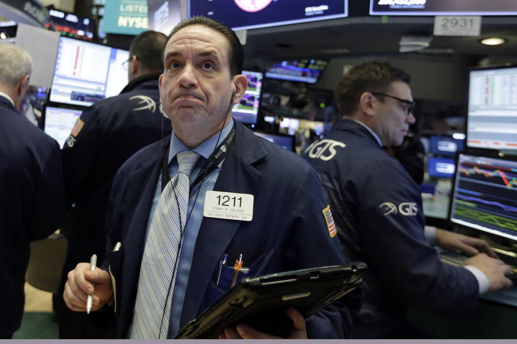 Trader Tommy Kalikas works on the floor of the New York Stock Exchange, Monday, Feb. 5, 2018. Stock markets around the world took another pummeling Monday as investors continued to fret over risin ...