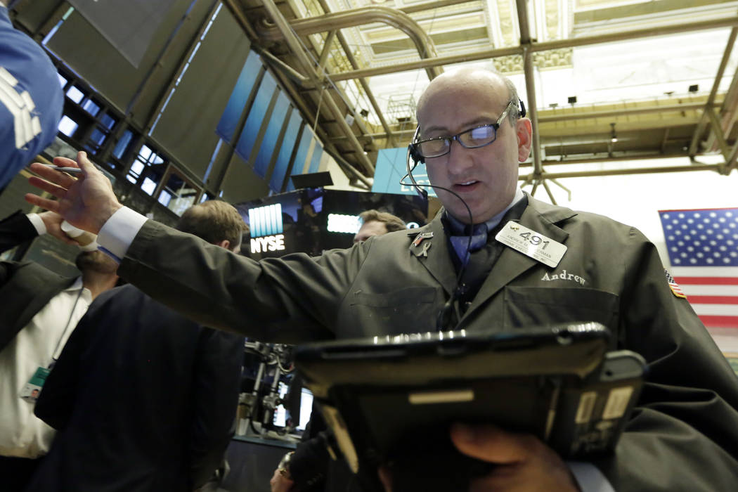 Trader Andrew Silverman works on the floor of the New York Stock Exchange, Monday, Feb. 5, 2018. Stock markets around the world took another pummeling Monday as investors continued to fret over ri ...