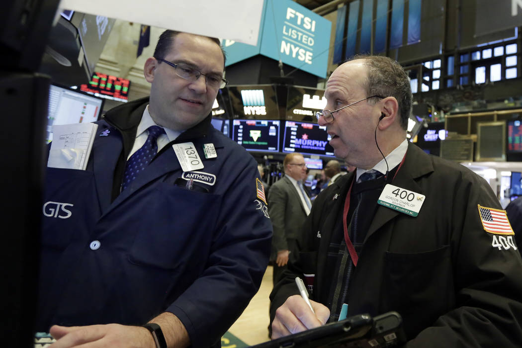 Specialist Anthony Matesic, left, and trader Gordon Charlop work on the floor of the New York Stock Exchange, Monday, Feb. 5, 2018. Stock markets around the world took another pummeling Monday as  ...