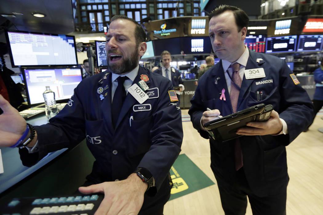 Specialist Michael Pistillo, left, and trader Brandon Barb work on the floor of the New York Stock Exchange, Monday, Feb. 5, 2018. Stock markets around the world took another pummeling Monday as i ...