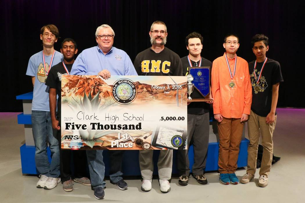 Team members who won first place in the Nevada Science Bowl, Feb. 3, 2018. Left to right: Alex Bean, Anish Kalakuntla,  Darwin Morgan, director of public affairs for the U.S. Department of Energy  ...