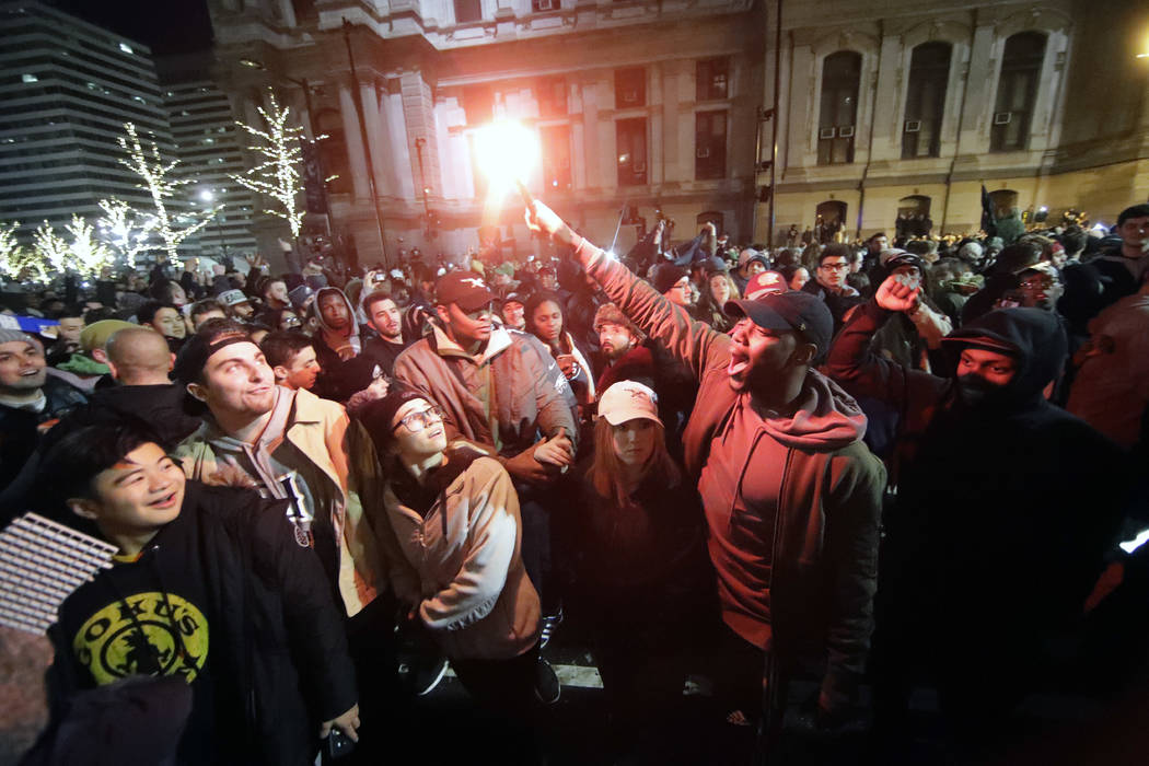 Philadelphia Eagles fans celebrate the team's victory in NFL Super Bowl 52 between the Philadelphia Eagles and the New England Patriots, Sunday Feb. 4, 2018, in downtown Philadelphia. (AP Photo/Ma ...
