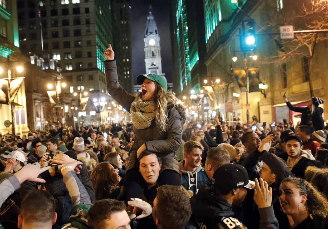 Philadelphia Eagles fans celebrate the team's victory in the NFL Super Bowl 52 between the Philadelphia Eagles and the New England Patriots, Sunday, Feb. 4, 2018, in downtown Philadelphia. (AP Pho ...