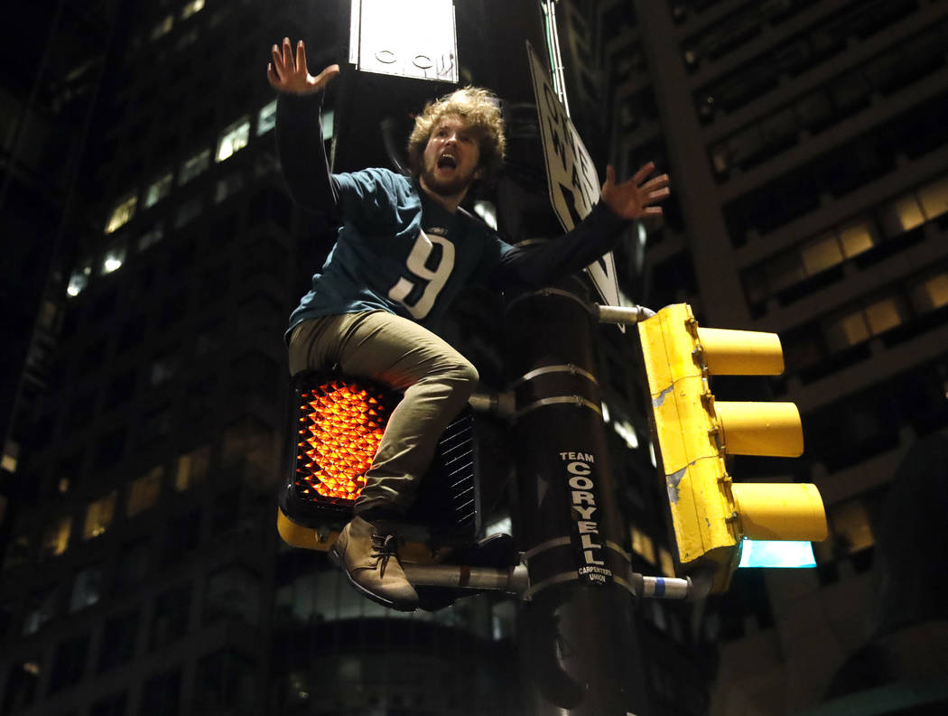 A Philadelphia Eagles fan celebrates the team's victory in the NFL Super Bowl 52 between the Philadelphia Eagles and the New England Patriots, Sunday, Feb. 4, 2018, in downtown Philadelphia. (AP P ...