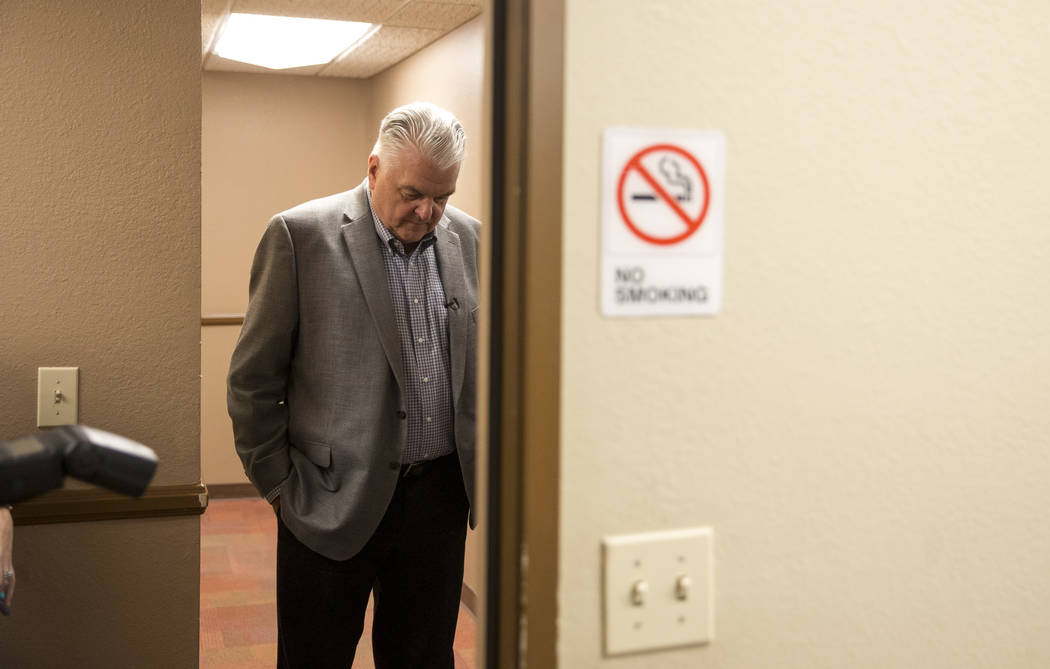 Clark County Commission Chairman and Democratic gubernatorial candidate Steve Sisolak stands in a hallway after a news conference at the Clark County Education Association building in Las Vegas on ...