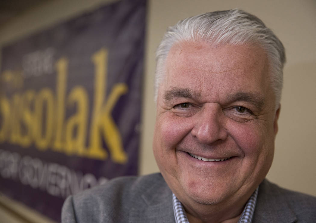Clark County Commission Chairman and Democratic gubernatorial candidate Steve Sisolak poses after speaking to CCSD employees during a news conference at the Clark County Education Association buil ...