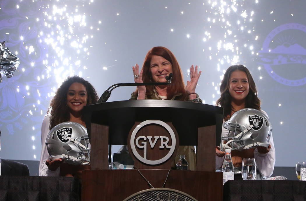 Fireworks light the hall as Henderson Mayor Debra March mentions the sale of a vacant 55-acre lot to the Oakland Raiders for a new headquarters and practice site west of the Henderson Executive Ai ...