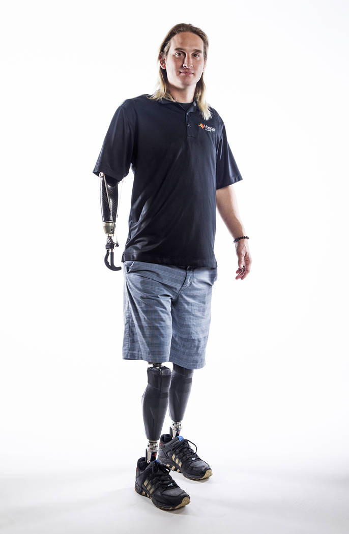 Cameron Clapp lost both legs above-the-knee and his right arm at the shoulder in a train accident. Photo of Clapp taken at the Hanger Education Fair & National Business Meeting on Wednesday, J ...