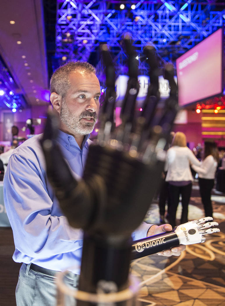 William Yule, upper limb specialist, discusses features of the multi-articulating bebionic hand by Ottobock at the Hanger Education Fair & National Business Meeting on Wednesday, January 31, 2 ...