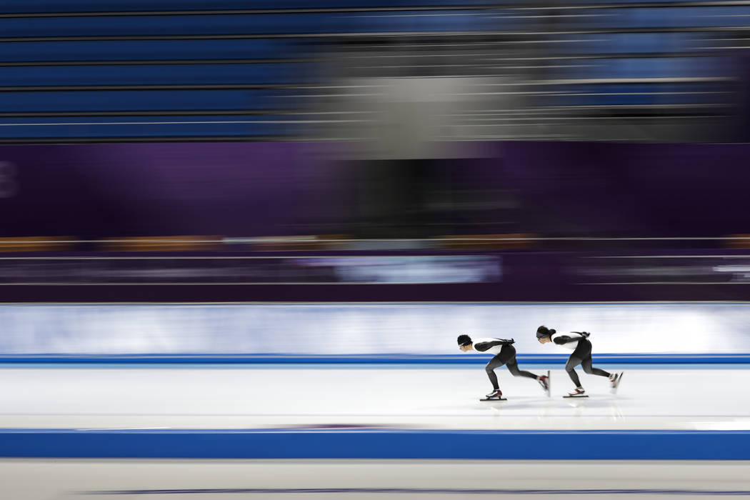 Japan's Seitaro Ichinohe, left, and Ryosuke Tsuchiya skate during a speed skating training session prior to the 2018 Winter Olympics in Gangneung, South Korea, Monday, Feb. 5, 2018. (AP Photo/Feli ...