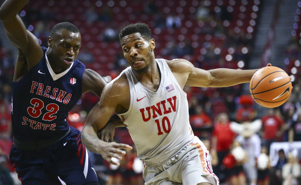 UNLV Rebels forward Shakur Juiston (10) drives against Fresno State Bulldogs forward Nate Grimes (32) during the first half of a basketball game at the Thomas & Mack Center in Las Vegas on Wed ...