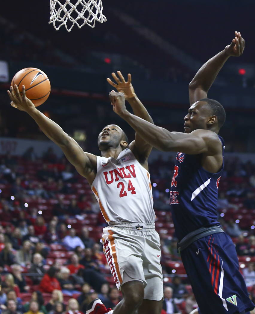 UNLV Rebels guard Jordan Johnson (24) gets fouled by Fresno State Bulldogs forward Nate Grimes (32) while going to the basket during the first half of a basketball game at the Thomas & Mack Ce ...