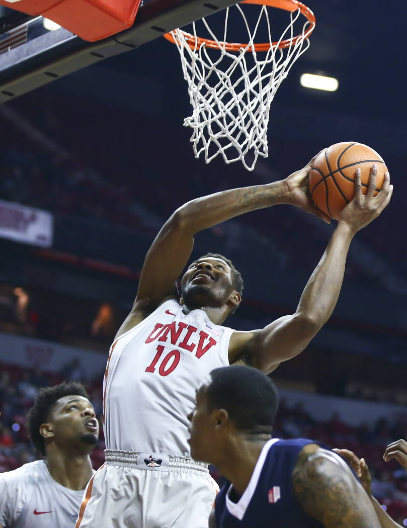 UNLV Rebels forward Shakur Juiston (10) goes to the basket against the Fresno State Bulldogs score during the first half of a basketball game at the Thomas & Mack Center in Las Vegas on Wednes ...
